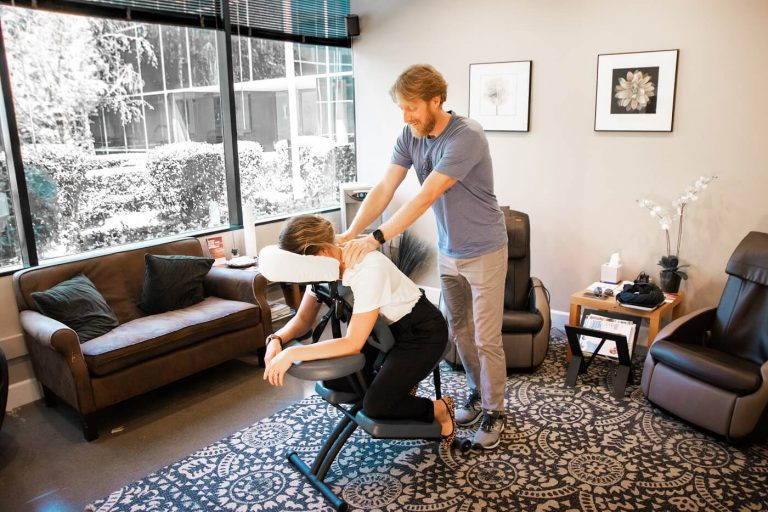 Masseuse Delivering Chair Massage